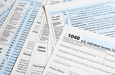 Tax forms on desk of accountant